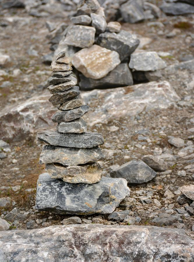Stone pyramids built by tourists from pieces of marble in the mountain Park stock photos