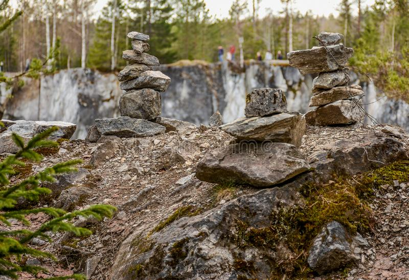 Stone pyramids built by tourists from pieces of marble in the mountain Park. Ruskeala royalty free stock image
