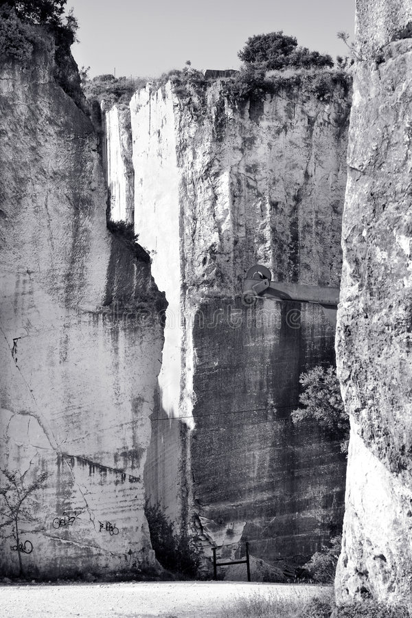 Stone quarry. Old abandoned stone quarry - black and white toned photo stock images