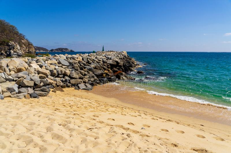 Stone quay in Huatulco Bay, Mexico. Preserved nature, quiet sand beaches, all for nature lovers at Huatulco Bay, Mexico stock photography