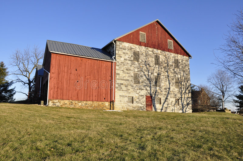 Stone And Red Wood Barn Stock Image
