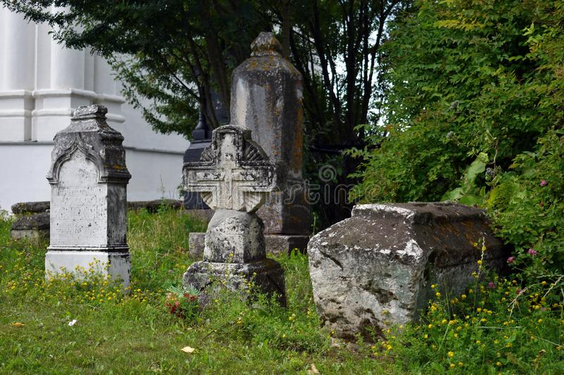 Old stone gravestones and ancient burials royalty free stock photo