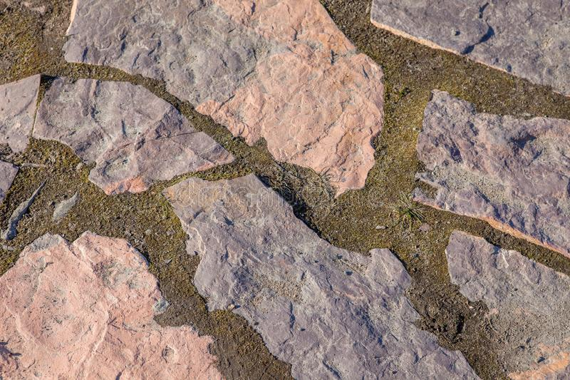Stone road from granite to the lake close-up royalty free stock photo