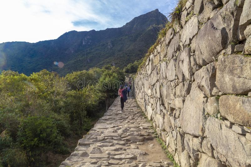 Stone Road, Machu Picchu, Peru - Ruins of Inca Empire city and Huaynapicchu Mountain, Sacred Valley. Indigenous, cusco, cloud, forest, architecture, scenic royalty free stock photography