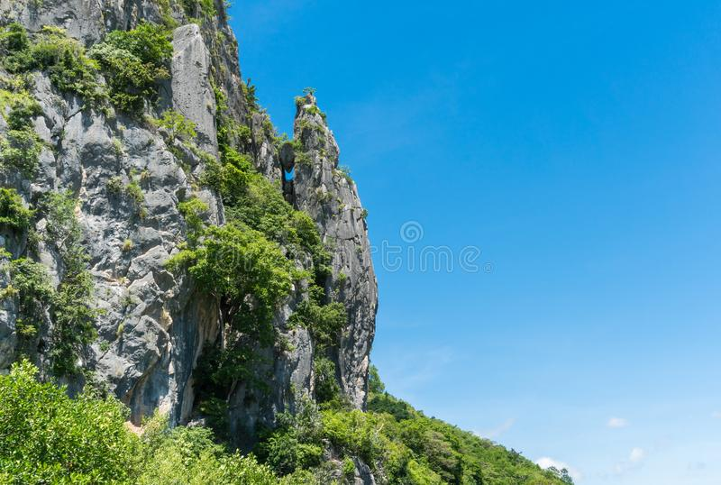 Crocodile or Alligator Mountain or Hill at Prachuap Khiri Khan T. Stone or rock mountain or hill with green tree and blue sky and water and cloud at Khao Dang royalty free stock photography