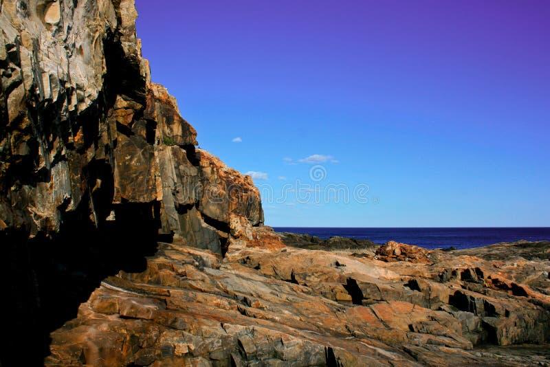 Stone Rocky Shoreline at Acadia National Park. Sone cliffs of the rocky shoreline at Acadia National Park near Bar Harbor Maine royalty free stock photo