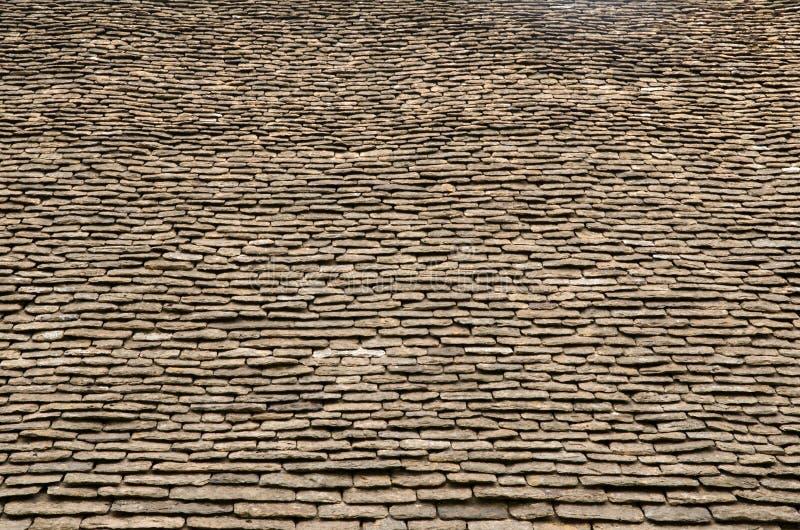 Stone roof tile. Vintage stone roof tiles from Tithe barn, Bradford on Avon, England stock photos
