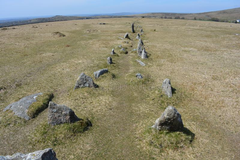 Double row of standing stones on Dartmoor, Merrivale, UK. A stone row, one of the features in the Merrivale Prehistoric Site dating to the Bronze Age, near stock images