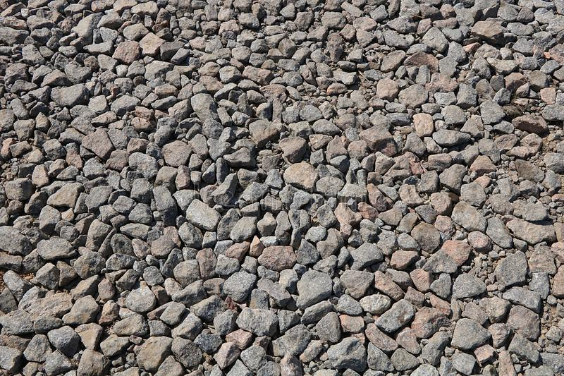 Stone rubble for use as a background or texture with a cement stain. royalty free stock photography