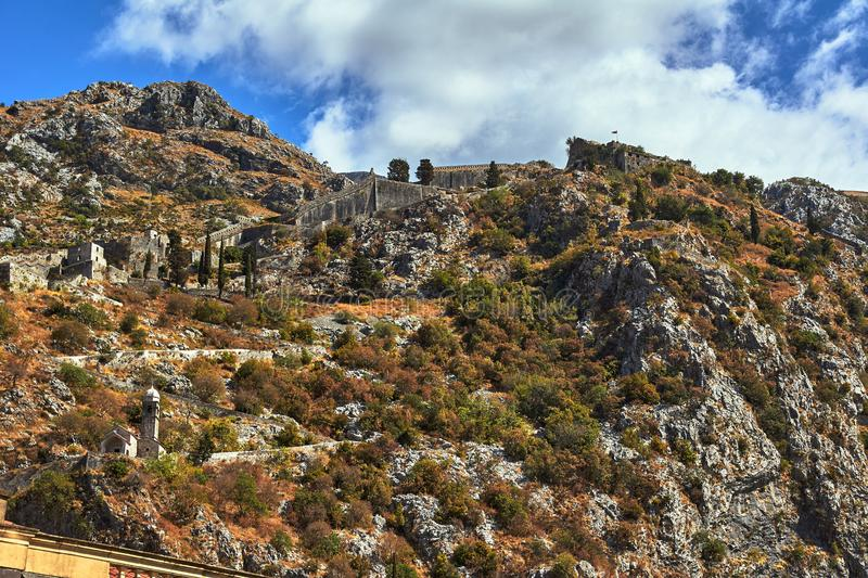 Stone ruins of the medieval fortifications of the city of Kotor stock photography