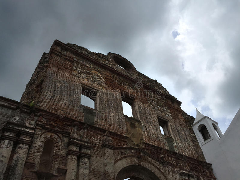 Stone Ruins of Santo Domingo Church in Panama. Santo Domingo Church ruins in Panama. Dark sky with light shining through. Looking up to the sky stock photo