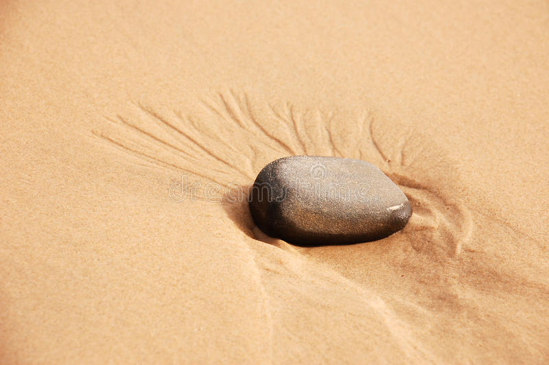Stone In Sand Royalty Free Stock Photo