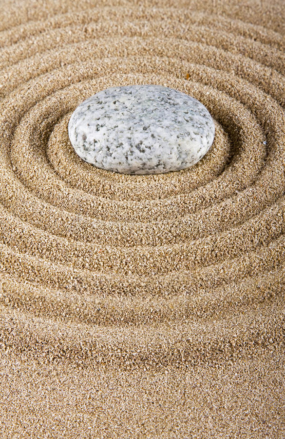 Stone on the sand. stock images