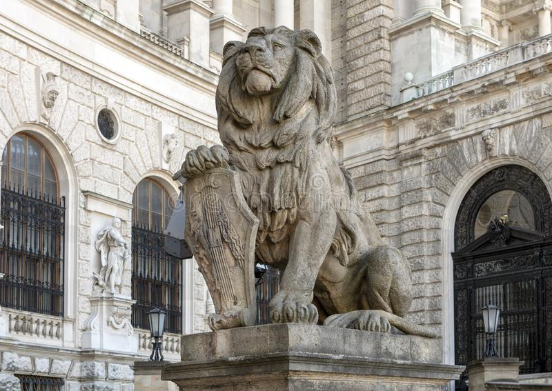 Stone sculpture Lion with Shield, Neue Burg or New Castle, Vienna, Austria. Pictured is a stone sculpture of a Lion with Shield, in front of the Neue Burg or New stock image