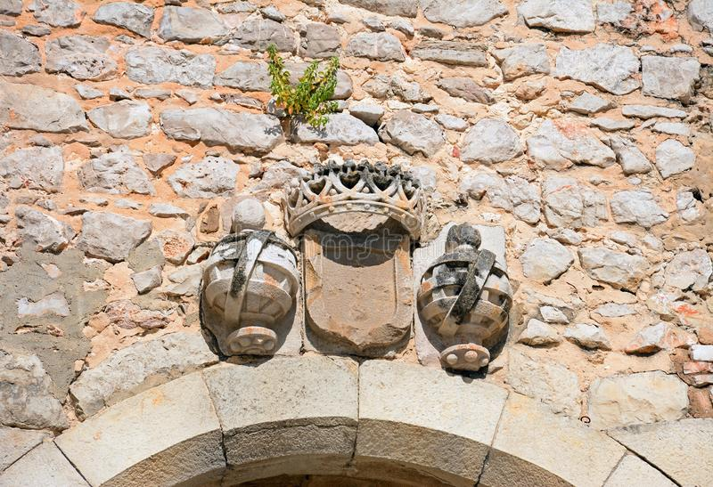 Stone sculptures above arch, Tavira. Stone sculptures above the archway along Rua da Galeria in the old town, Tavira, Algarve, Portugal, Europe stock image