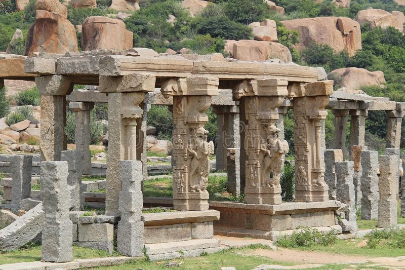 Stone sculptures and bas-reliefs on columns at the entrance to Pushkaran. Pushkarani is a sacred lake on the way to the Vitthala t royalty free stock images