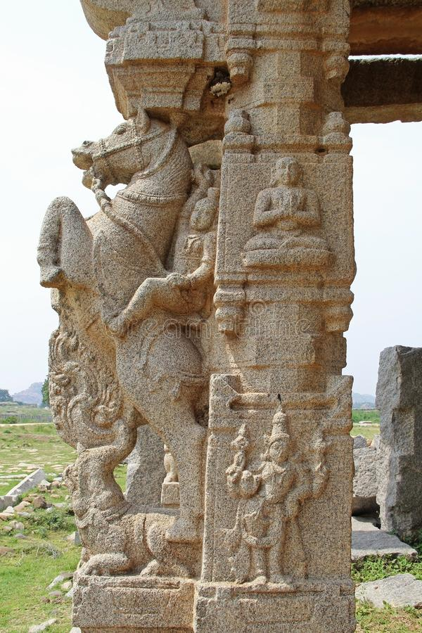 Stone sculptures and bas-reliefs on columns at the entrance to Pushkaran. Pushkarani is a sacred lake on the way to the Vitthala t stock photo