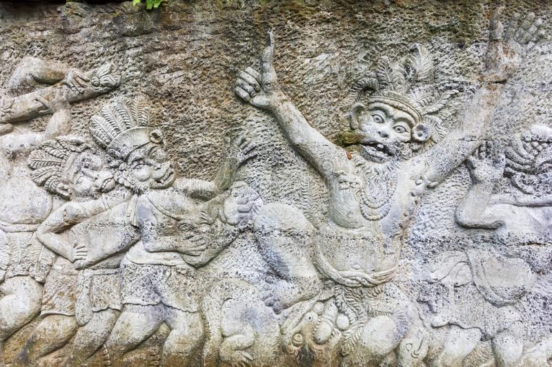 Stone sculptures covered in Ubud Monkey Forest Sanctuary. Bali, Indonesia stock images