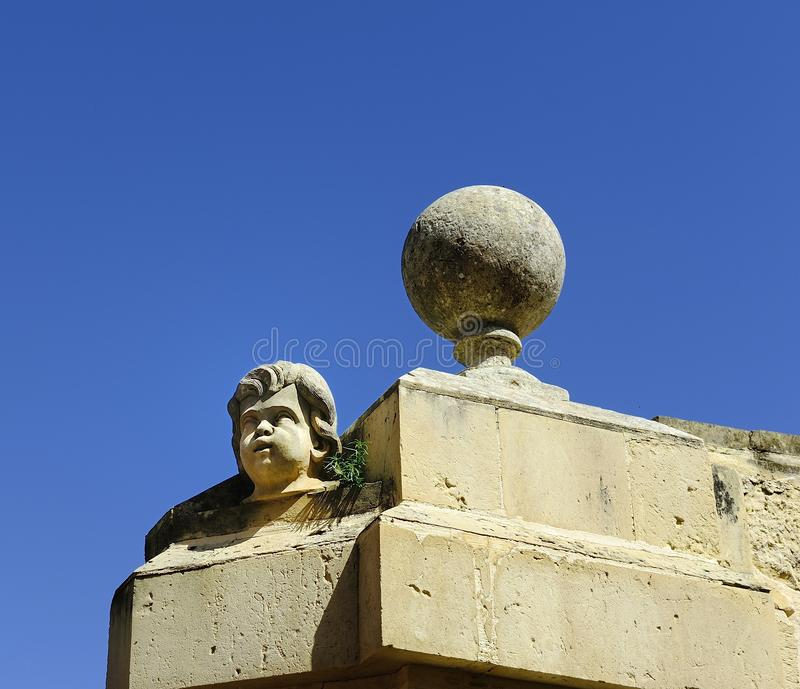 Stone sculptures face in the sunshine royalty free stock photos