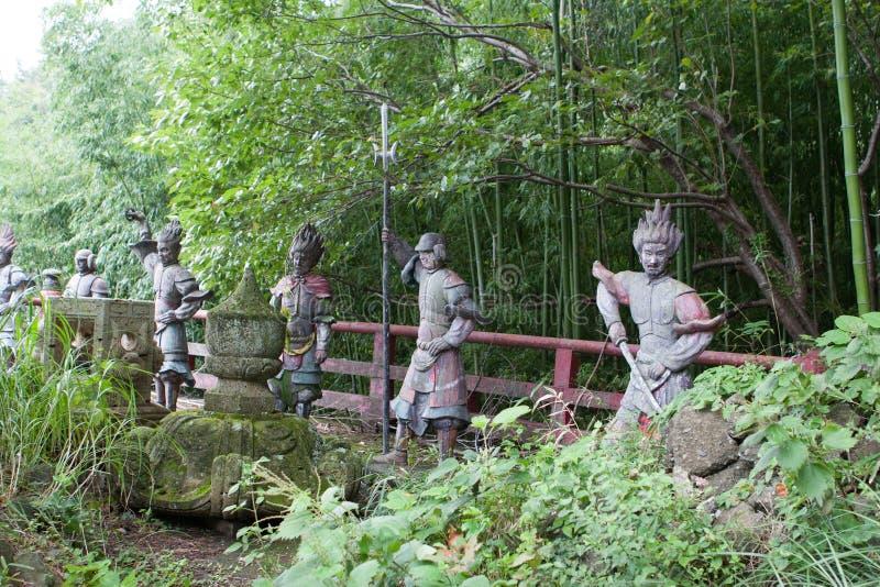 Stone sculptures of japanese samurais. In park near buddist temple. Atami. Japan royalty free stock photos