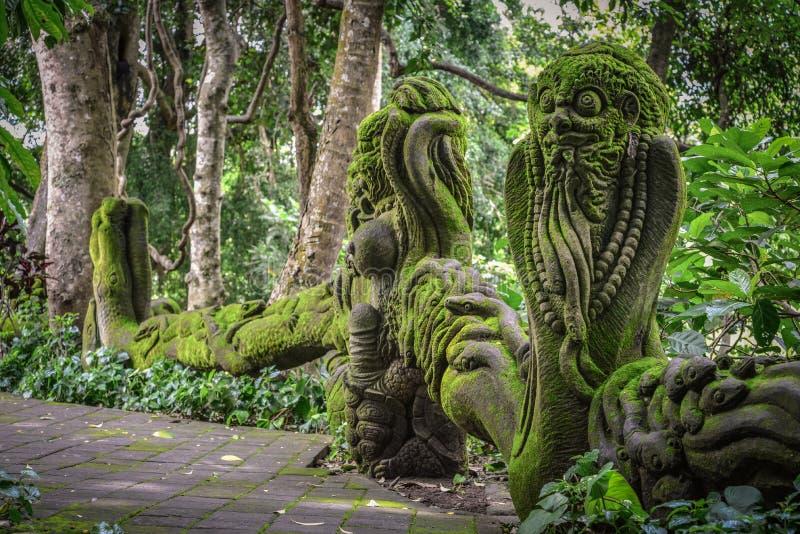 Stone Sculptures in Sacred Monkey Forest. Sanctuary Ubud Bali Indonesia royalty free stock photo
