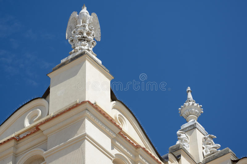 Stone sculptures. On the top of the Sukiennice trade building at main square in Krakow, Poland stock photo