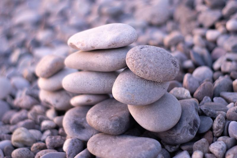 Stone on sea shore closeup. pebbles stacked on the beach.  stock image