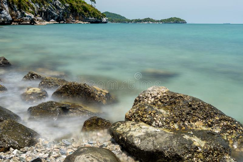 Stone in sea and wave on morning time with long exposure. The Stone in sea and wave on morning time with long exposure royalty free stock photo