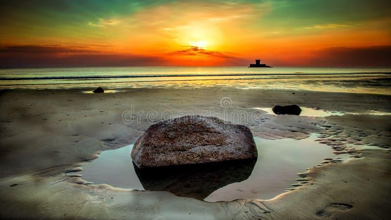 Stone Beside Seashore at Sunset stock photo