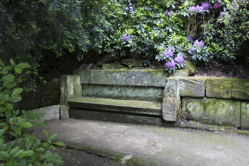 WENTWORTH, UK - June 1, 2018. Stone seat set within the grounds of Wentworth Woodhouse. Rotherham, South Yorkshire, UK - June 1, stock image