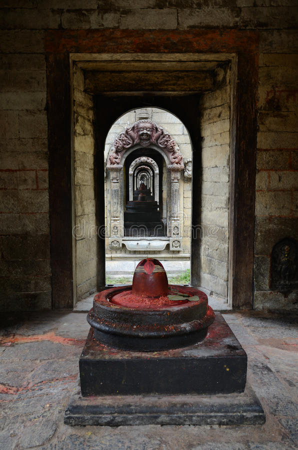Stone Shiva lingam. In Pashupatinath temple complex on Bagmati River in Kathmandu valley, Nepal stock photos