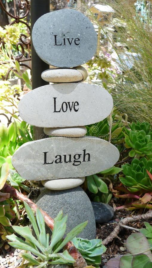 Stone Signs. Stones with letters of Live, Love, Laugh royalty free stock photo