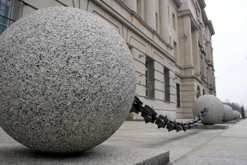 Stone spheres connected by chain, architectural detail stock photo