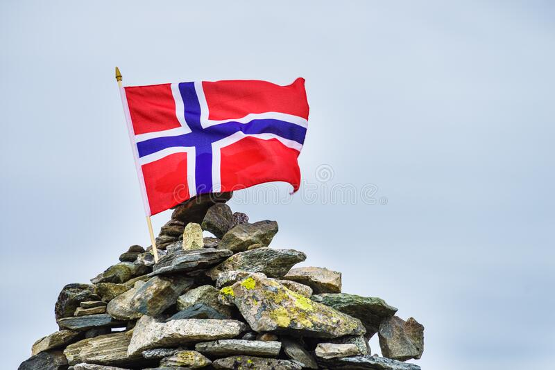 Stone stack with norwegian flag stock photography