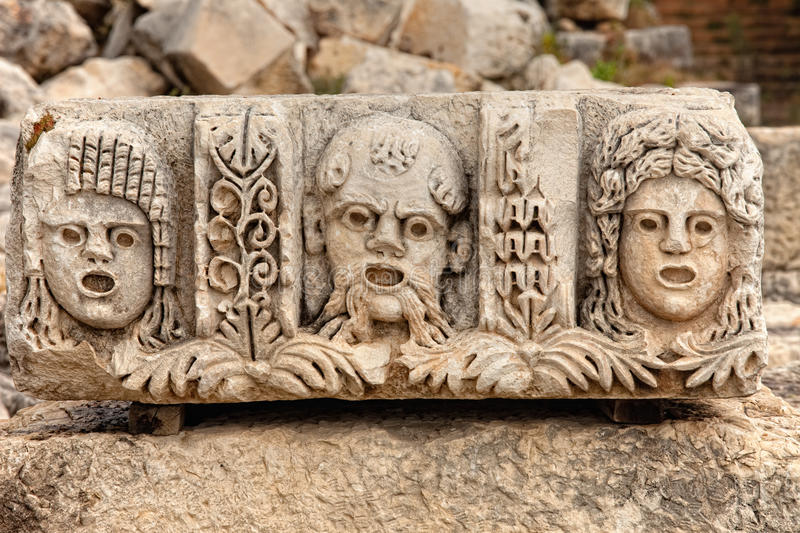 Stone stage masks at Myra Turkey royalty free stock image