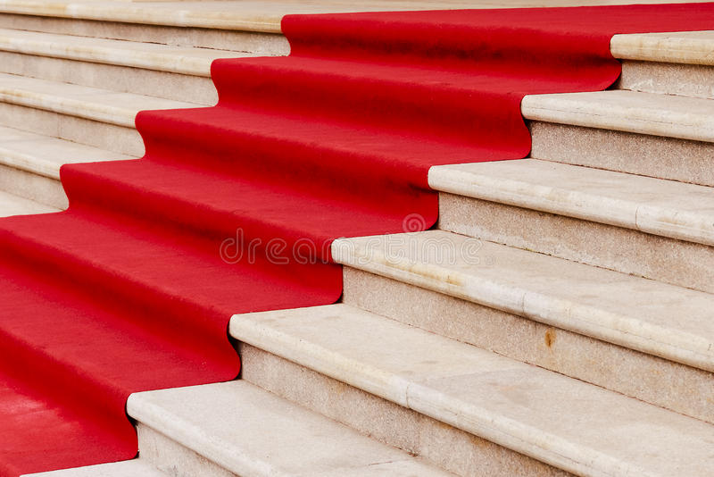 Stone staircase. And red carpet stock images