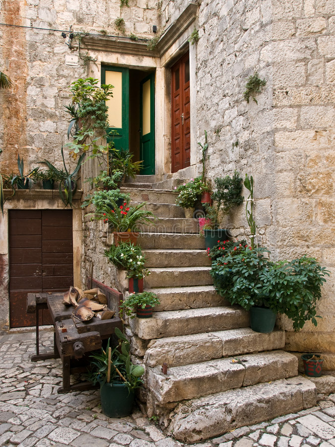 Stone Staircase. With plants in a medieval city with cobblestone pathways stock images
