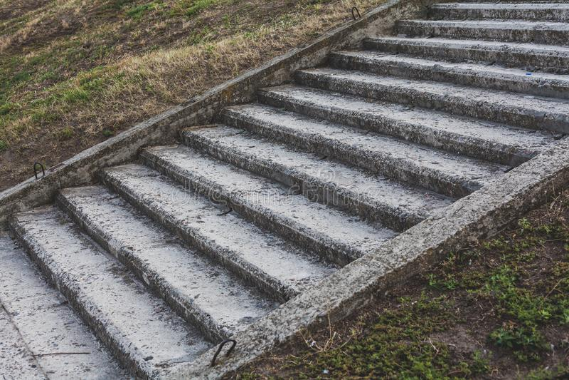 Stone staircase on the earthen slope stock photos