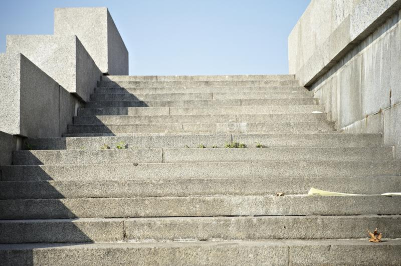 Stone stairs. An old granite staircase on a embankment stock images
