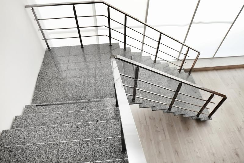 Stone stairs with metal railing indoors royalty free stock images