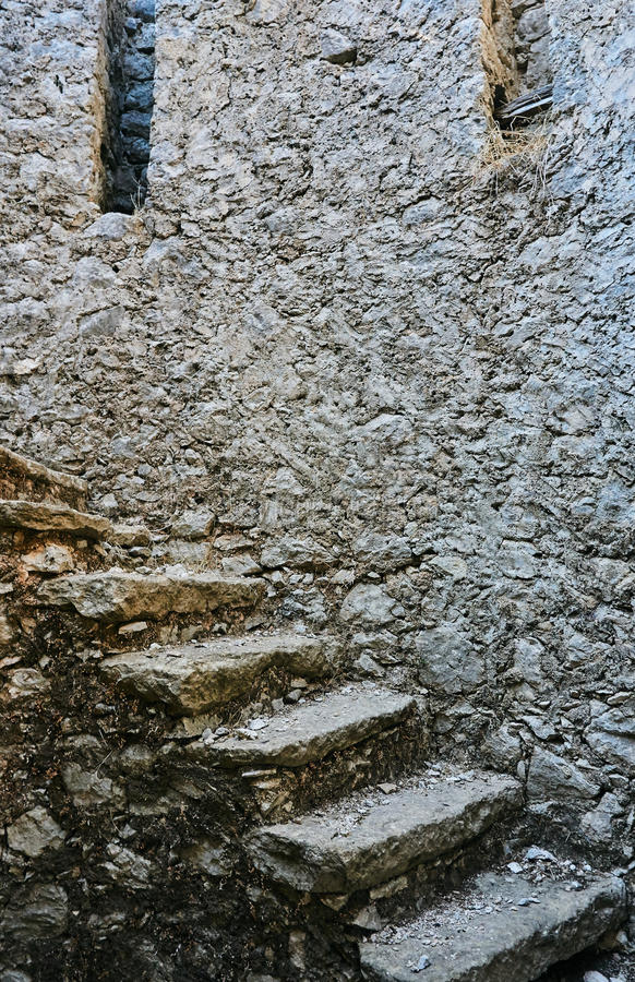 Stone stairs in a ruined windmill stock photo