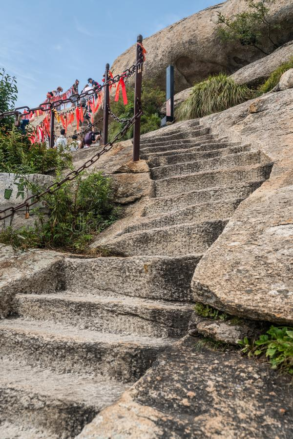 Stone stairs to the summit of West Peak in Huashan mountain. Cut in a rock stone stair steps leading to the summit of a West Peak on Huashan mountain, Xian stock photos