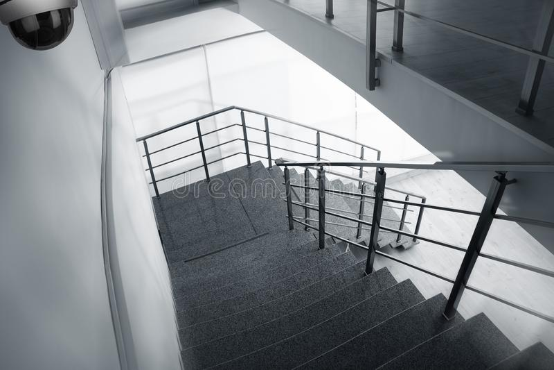 Stone stairs under CCTV camera surveillance. Above view stock photo