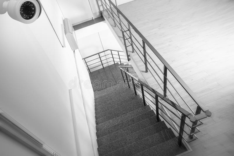 Stone stairs under CCTV camera surveillance. Above view royalty free stock image