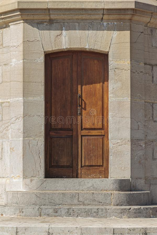 Stone stairs and wooden door. Foreground of stone stairs and wooden door stock photography