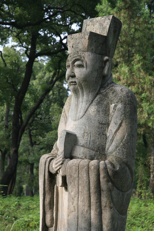 Stone statue of ancient civil official (Guardian), Cemetery of Confucius, Qufu, Shangdong Province, China stock photos