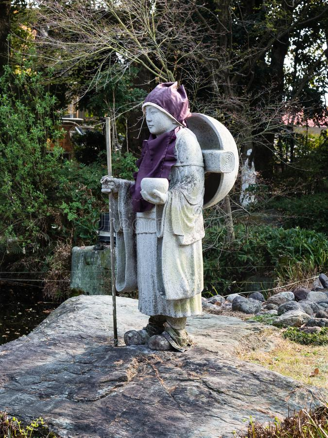 Stone statue of a Buddhist pilgrim in Japan stock photos