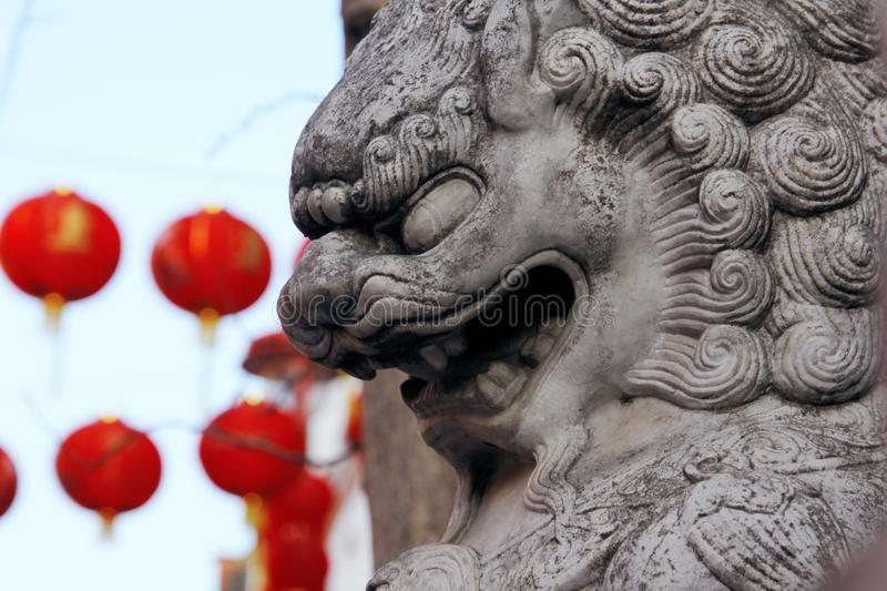 Stone statue of the Chinese lion in China town. royalty free stock image