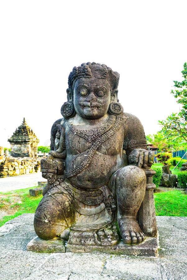 Stone statue of demon giant guard. Monster giant creature guarding the temple complex in the historical ruins of medieval royal palace in south east asia royalty free stock photography