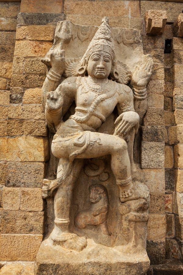 Stone statue of guardian Hindu deity. In Gangai Konda Cholapuram Temple, Tamil Nadu, India stock photography